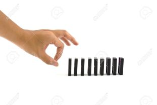 9623181-hand-ready-to-push-domino-pieces-to-cause-chain-reaction-stock-photo